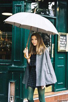 Georgia wears the Wool Cape, Lulu Crop Top; Mini Skirt, Opaque Pantyhose  with Umbrella. London, October 2014. #AAFALL #AmericanApparel