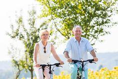Senior couple, woman and man, riding their bikes