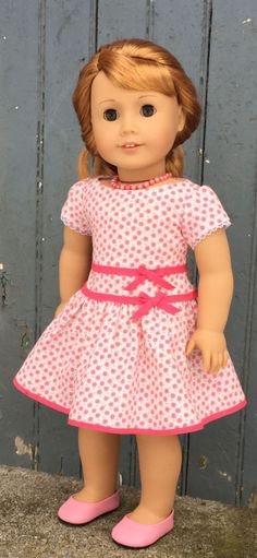 Pink and white flowered retro style dress by GumbieCatDollClothes on Etsy. Made with the Special Dress pattern, found at https://www.pixiefaire.com/products/special-dress-18-doll-clothes. #pixiefaire #specialdress