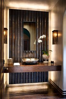 Love this dark bamboo wall. This is perfect for small powder room.