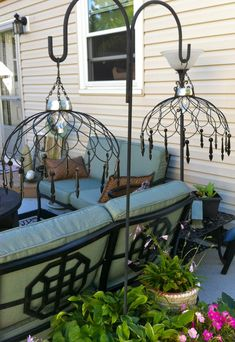 Thrift Store DIY Garden Projects | The Garden Glove - From 'Ann's Garden Path', these hanging chandeliers from wire baskets are really clever, and easy and inexpensive to make. The wire baskets are from thrift stores, and they are lit with a $1.50 Target solar light. Hang them on Shepard hooks or hang them in a tree.