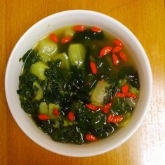 Late night soup for me. A lil under the weather so made soup w/baby bok choy, chicken broth, wakame and goji berries... Healthy, simple, nutritious, soothing..