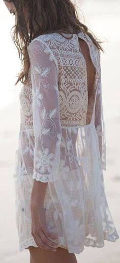 My dad just brought back something so similar from Hawaii for me and I love it! Great bikini coverup! -- White Back Crochet Detail Blouse