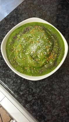Breakfast was green nice cream/smoothie bowl which was so delicious I blended 2 cups of baby spinach with 1/2 cup of water first, then added 2 frozen bananas, handful of frozen grapes, frozen mango, tsp of @Bioglanuk wheatgrass powder, 1/2 cup of water (or less for smoother texture) and blended until smooth. Topped with chia seeds, bee pollen and desiccated coconut. Yum. #fooddiary #fit #fitfood #healthy #healthyfood #cleaneating #eatclean #eathealthy #food