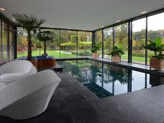 Indoor swimming pool by VSB Wellness Small Backyard Pools, Backyard Pool Designs, Indoor Swimming Pools, Swimming Pool Designs, Outdoor Pool, Casas Country, Inside Pool, Piscina Interior, Luxury Pools