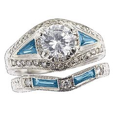 A platinum, diamond, and sapphire engagement ring.