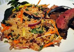 Colorful carrots, quinoa and fresh basil make a terrific salad for lunch.