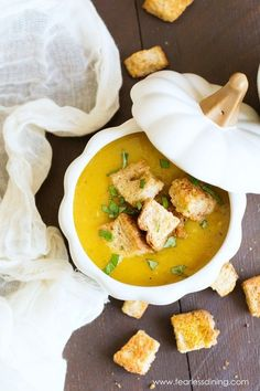 Get ready for fall comfort food with this creamy vegan roasted acorn squash soup. Topped with homemade pumpkin spice croutons.