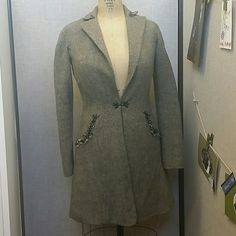 Wool jacket by Max Studio. Warm and comfortable fitted long sleeve jacket with adorable details. It has two pockets in the front with navy blue detail as pic three shoes. Also a beautiful closure in front. Max Studio Special Addition. Used but in excellent condition. 70%wool and 30% viscose. Lining in excellent condition. Max Studio Jackets & Coats Trench Coats