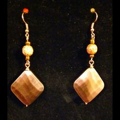 """These earrings hang about 2 inches long & are very light weight. Crafted with copper wire, glass decorative beads & diamond shaped copper colored beads.    To add this item to your collection simply comment below with your email address OR if you're shopping directly from my online store just click add to shopping cart!     If mailed, shippingcharges will apply.    Message me if you live in Columbia, SC or close surrounding areas to set up a """"Meet & Deliver"""".   Shop this product here…"""