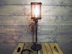 "Table Lamp w/ Rusted Cage 22"" Tall with Repurposed Iron Weight - Upcycled Iron Weight Lifting 2.5 lb Weight Circa 1970 with Steel Pipe by VexDecor on Etsy https://www.etsy.com/au/listing/233884752/table-lamp-w-rusted-cage-22-tall-with"