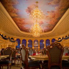 """(You are eating in a replica of the castle from Beauty and the Beast, after all.) The decor in the main dining room, the Beast's """"ballroom,"""" is very Old World: Picture a 20-foot coffered ceiling painted with cherubs and 18-foot arched windows overlooking a faux-snow-filled courtyard."""