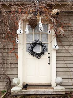 I <3 this Halloween entrance and the ghost gourds: http://www.bhg.com/halloween/indoor-decorating/halloween-decorations/#page=22