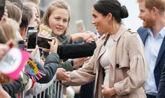Meghan, Duchess of Sussex meeting fans and holding baby bump on the street during 'Walkabout' on October 2018 in Auckland, New Zealand. The Duke and Duchess of Sussex are on their official Get premium, high resolution news photos at Getty Images