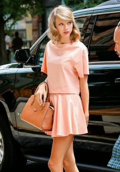 Taylor Swift in Alice and Olivia peach boxy blouse and flared mini skirt set that complements this angel beautifully