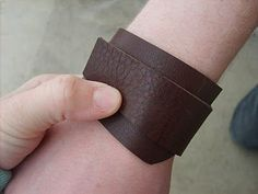 Good leather cuff tutorial. I'm wondering if maybe I could take men's style watch and make a leather cuff-cover for it. :) I think it'd look super spiffy ^_^