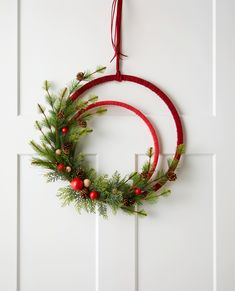 49 Pretty Christmas Wreaths to DIY Now - Minimalist without being Grinch-like, this leather wreath is ideal for homes with modern decor. Homemade Christmas Wreaths, Christmas Wreaths For Front Door, Holiday Wreaths, Holiday Crafts, Christmas Crafts, Christmas Decorations, Christmas Ornaments, Holiday Decor, Christmas Christmas