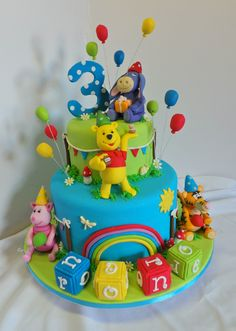 Winnie the Pooh and friends birthday cake. Fondant figurines were brought in by client made by Xanop's Sugar Art.