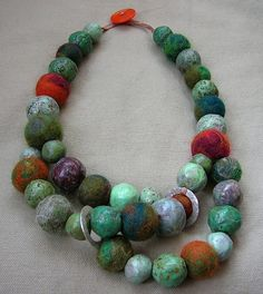 mix of paper & felt beads; tutorial for making the beads from recycled newspaper;