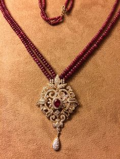 Ruby strands with diamond pendant