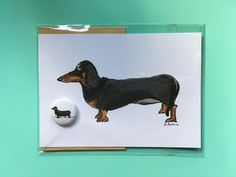 A personal favourite from my Etsy shop https://www.etsy.com/uk/listing/579061630/daschund-illustrated-card-and-badge