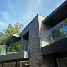 Casas de estilo moderno de David James Architects & Associates Ltd
