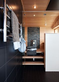 Sauna with stone, raised floor, window for natural light, glass wall. Basement Sauna, Sauna Room, Saunas, Sauna Design, Finnish Sauna, Spa Rooms, Grey Bathrooms, Bathroom Inspiration, Interior Architecture