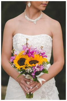 sunflowers and purple blooms are a unique mix for a bridal bouquet - thereddirtbride.com - see more of this wedding here