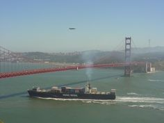 "Yang Ming container ship ""Success"" with an ""escort"" of a blimp and a helicopter entering SF Bay, California - (Photo © 2009 JAK Keeran)"