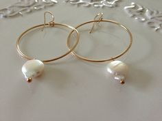 Hoop earrings with stunning coin pearl