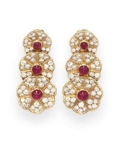 A PAIR OF DIAMOND AND RUBY EAR PENDANTS, BY VAN CLEEF  ARPELS  Each designed as three graduated and overlapping circular-cut diamond florets each with a cabochon ruby pistil, mounted in 18k gold, with French assay marks and maker's mark for Pery et Cie  Signed VCA for Van Cleef  Arpels, N.Y., no. 61381