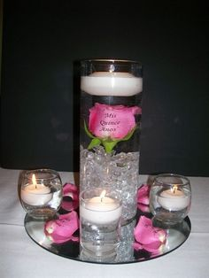 """submerged rose centerpiece.. ignore the """"miss quince anos"""" on the glass! haha"""