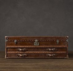 "Mayfair steamer low chest in vintage cigar leather. 55""W x 16""D x 20""H. A bit narrow."
