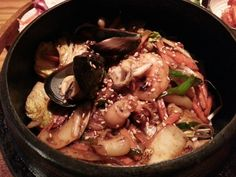 Boiled rice with seafood in iron pot. It is not spicy it seems. The name of restaurant is 'SOT'. Means iron pot. You can find this restaurant at Hapjeong, Seoul.