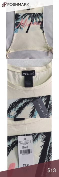 Wet seal muscle MIAMI tee with open sides Wet seal muscle MIAMI tee with open sides.                                                                                                                                                                                                                                                                      🌸 Fast shipper 🌸 Accept reasonable offers 🌸 I do bundle discounts too                                               🌸 No trades Wet Seal Tops…