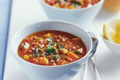 Super-healthy vegetables bathe in a bowl of low-fat lentil soup in this easy winter warmer.