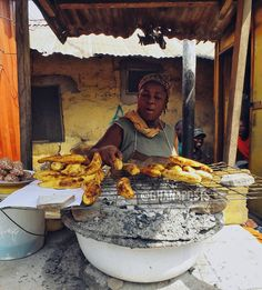 Roasted plantain seller, Ghana.