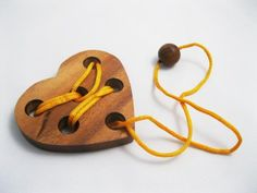 """$3.95 - HEART PUZZLE , Wooden Puzzle Game, Strategy Game, Brain Teaser, Travel size ... Remove the string from the heart (Instruction or Solution included) Dimensions: approx. 3.75"""" w x 3.25 h """" x 1/2"""" thick or 9.5 cm x 9 cm x 1.2 cm."""