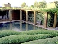 Fernando Caruncho has been designing contemporary, minimalist gardens internationally for over 30 years. He works with light and shade and uses cloud-like topiary very effectively.