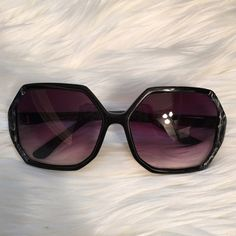 Betsey Johnson Sunglasses Betsy Johnson Sunglasses. Black with blue marble texture on front. Heart on end. Used. Has minor scratches/ imperfections but overall still wearable. Great boho / 70s vibe! Betsey Johnson Accessories Sunglasses