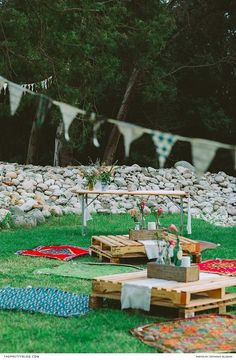 Outdoor wedding seating area with pallet furniture and colourful blankets | Photograph by Stephanie Veldman |