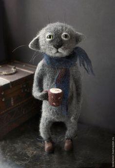 Кот с чашкой кофе.