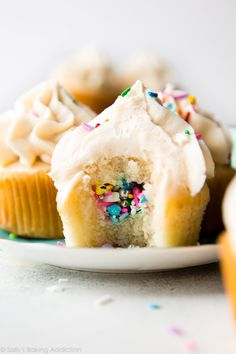How to make party piñata cupcakes filled with sprinkles! Easy to make and ready for any celebration. Recipe on sallysbakingaddiction.com