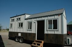 This 26′ tiny house on wheels features a side entrance and is the latest tiny home designed and custom built for a client by Tiny Idahomes for $39,400. Inside there's about 175 sq. ft. …