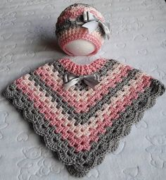 Stunning handmade baby poncho and hat. Made with coconut ice baby cakes yarn. Pink Peach and grey. Size Stunning handmade baby poncho and hat. Made with coconut ice baby cakes yarn. Pink Peach and grey. Crochet Pullover Pattern, Crochet Poncho Patterns, Baby Knitting Patterns, Free Knitting, Baby Girl Crochet, Crochet Baby Clothes, Crochet For Kids, Hand Crochet, Diy Crafts Crochet