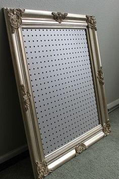 Framed pegboard for jewelry or other knickknacks.  I do like the idea of using pegboard, but it is so ugly all by itself!  Colored, or painted pegboard in a frame is an interesting organizing idea.