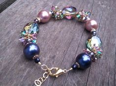 Beautiful pink/purple bracelet packed with crystals by Tootsiejos, $25.00