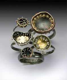 Seed pearls and crystal beads in little pods... Handmade by Brandon Holschuh.