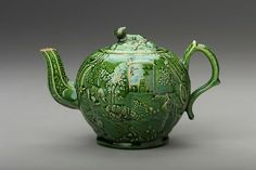 Slightly melon form with footband, paneled spout, leaf-decorated scroll handle, inset cover with lamb finial. Relief designs of house in landscape with sheep, cow and swans on each side. Teapot Design, Cute Teapot, English Pottery, Tea Culture, Brewing Tea, Ceramic Teapots, My Cup Of Tea, Chocolate Pots, Coffee Set