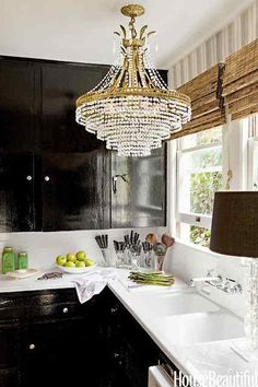 Nicely Tailored and fabulous Window Shades, chandlier in kitchen, black cabinets